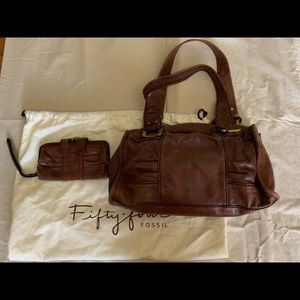 Fossil brown leather bag and wristlet.